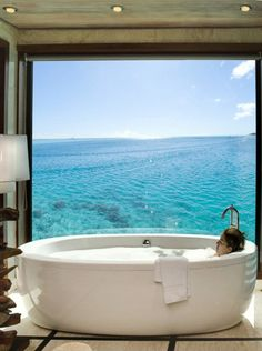 Love the large bath window. i WOULD NEVER LEAVE