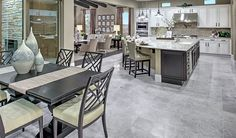 This elegant nook in Las Vegas, NV, overlooks an impressive kitchen and back patio   Reagan plan by Richmond American