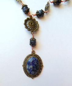 bronze colour necklace with sodalite beads and pendant.