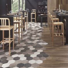 Trend alert: hexagonal tile! Forget squares & diamonds, this new shape is where it's at. And when you mix it with another flooring in the same space? Amazing.  courtesy of @iconstonetile