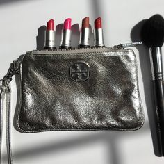 Tory burch wristlet 7 inches x 4.5 inches . Spotless inside. New without tags Tory Burch Bags Clutches & Wristlets