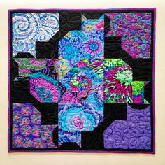 Mini cat quilt by Brenda Moore, photo by Bendigo Lioness.  Based on the free Kool Kats quilt pattern by Patti Carey. Kaffe Fassett fabrics.
