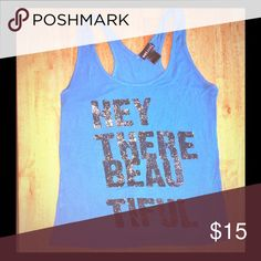 """✨""""Hey There Beautiful"""" Turquoise/Blue Tank✨ ✨""""Hey There Beautiful"""" Turquoise/Blue Racer Back Tank✨ Super Soft material • There is no size marking for some reason, so I'm guessing it is between a Small & Medium • The wording is Black w/ Gold specks flickered throughout the letters • """"distressed look"""" • Very cute top! 💫✨ Tops Tank Tops"""
