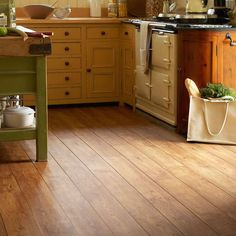 Wood effect lino. Love colour and style for bathroom floor. Very warm.