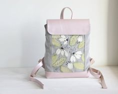Genuine leather backpack in combination with fabric. Decorated with flower applique embroidery, all handmade. In the flower buds embroidered sequins. Skin color is light pink with mother of pearl. Embroidered Bag, Embroidered Flowers, Flower Applique, Embroidery Applique, Flower Bag, Mother Pearl, Pink Leather, Leather Backpack, Fashion Backpack