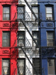 Red, White & Blue Building with black fire escape stairs