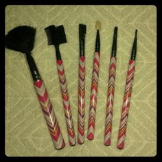 Set of 6 Pink Stipe Make up Brushes Super cute 6 piece makeup brush set. They have super cute girly colour scheme that's chevron. All brushes have been thoroughly cleaned and dried. These brushes are used but cleaned and sterilized with non scented anti bacterial soap.  Please feel free to make an offer! Comment, like, share, bundle, and / or negotiate! ?? ?? ?? Thanks! Makeup Brushes & Tools
