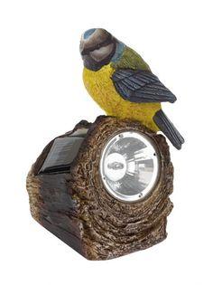 Lámpara solar con tronco y pájaro.