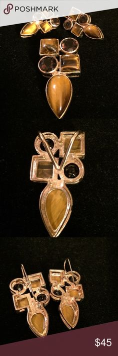 Pendant with matching earrings Costume pendant and matching earring. Weight is Approx 31g. I can't find any stamp on the inside, but it seems the gems are real, but I'm not sure. Looks like tiger eye and smoky Quartz. Priced accordingly I do not have any paperwork on this item. Jewelry