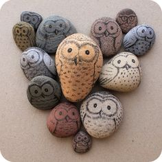 Image of owls drawn on pebbles...  Newton had talked of having picked but pebbles on the ocean of knowledge. Very fitting that this wise bird should be painted on them.