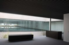 This swimming center by Eddea Arquitectos is located on the outskirts of Barbate in Spain. The design of the center seeks to provide an impressive health experience through a relationship with the natural landscape.The sports pavilion is housed around an interior courtyard and hall, which incorporates filtered sunlight into the center. Situated around this space are changing rooms, a fitness center, and the swimming pools. The swimming pools bask in a warm light from radiant ceiling…