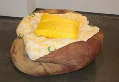 Those who love to tuck in to a fresh-baked potato will get a kick out of the Baked Potato Bean Bag by Brook of B Fiber and Craft Emporium. The chair was a part of her BFA thesis show and even comes with a satin butter pillow. The baked potato bean bag is