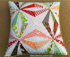 i think i've a similar pattern + templates in my boxes...should finally use them.   this pillow is awesome!