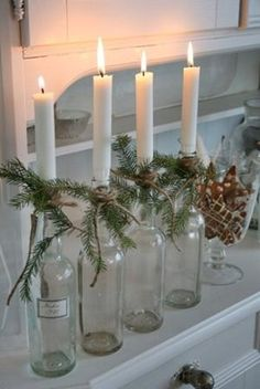 Simple and Pretty Scandinavian Christmas Decorating Idea. Good use for wine bottles saved throughout the year.