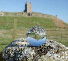 https://flic.kr/p/s7JhHj | Dunstanburgh through the ball. ( Explored ) | Have a wonderful weekend everyone.