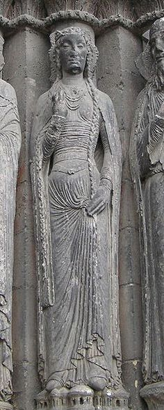 Angers cathedral, France, sculpture at West Portal.  (c. 1130-1160 per Koslin, Désirée and Janet E. Snyder, eds.: Encountering Medieval Textiles and Dress: Objects, texts, and Images, Macmillan, 2002, ISBN 0-3122-9377-1)