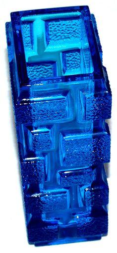 13262__Brickwork_vase. Description: Colour: Blue Size: 185mm h,  94mm l,  70mm w 1200g. Designer: Jiri Zejmon, Rudolfova Hut before 1973. Pattern number 13262. Ref: Sklo Union: Art Before Industry p 115.