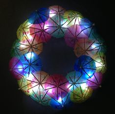 Summer wreaths crafted with paper cocktail umbrellas are all over Pinterest. But what about a LIGHT UP version? That's an FBL exclusive, folks! Secure LED string lights behind those tiny drink umbrellas. Tiki fabulous.