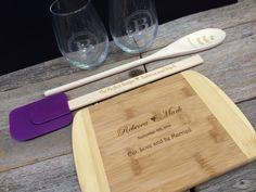 Spread the love with a custom gift set that includes a spatula, spoon, cutting board and set of stem-less wine glasses. This personalized gift is the perfect way to welcome a loved one to their new home!