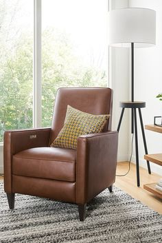 Recline in style with our leather Ellison recliner.