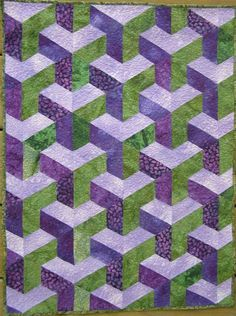 2 quilts made doing english paper peicing technque