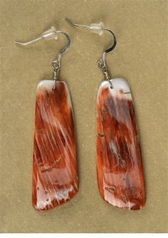 Earrings by Jimmy Calabaza- Sterling silver and spiny oyster shell- 2 x 5 x 1 in- at the Gerald Peters Gallery, Santa Fe.