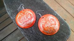 Large Orange Coin Earrings with Gold Elephant Etching by atiltKC $22.50 atiltKC.etsy.com #orange #earrings #jewelry #elephant #india #baliwood #unique #large #big #hepteam #spring