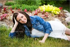 Pretty senior pictures laying in the grass. #arisingimages #michigan #seniorpics #girl #photography