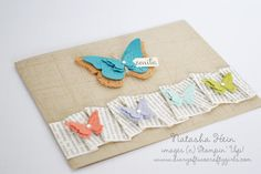 buterfly cut outs, news print paper border & cork