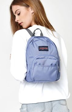 ef4ca2cc98c1 Keep everything you need for the day in the Half Pint Backpack by JanSport.  This small and light mini backpack features a front utility pocket and  zipper ...