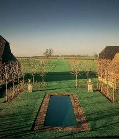 A perfectly sited pool in the English countryside at the home of David Hicks, now his daughter Allegra's.  A small dipping pool surrounded by cobblestones giving the appearance of a pond.