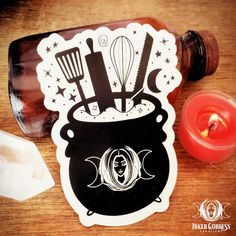 """Add some magick to your kitchen decor or appliances with an exclusive Kitchen Witch Magick Decal from Inked Goddess Creations. Designed by Morgan, owner of Inked Goddess Creations, this clear-backed Kitchen Witch Decal can be added to kitchen appliances, your personal witchy cookbook, and more to add kitchen witch energy to your sacred space! Each order is for a 1 Kitchen Witch decal measuring approximately 4"""" long x 3"""" wide. Other items in the picture are not included and are for size reference Herbal Kitchen, Baking Logo, Roasted Root Vegetables, Kitchen Witchery, Cooking Dishes, Witch Decor, Thing 1, Organic Sugar, Breakfast Items"""