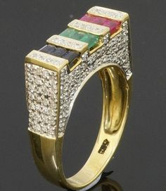 14Carat Gold Baguette Sapphire Ruby Emerald & Diamond Cluster Ring (Size T 1/2)  https://www.jollysjewellers.com/product/14carat-gold-baguette-sapphire-ruby-emerald-diamond-cluster-ring-size-t-12/