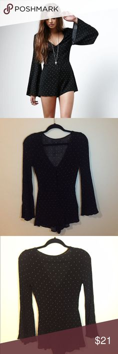 P. S. Erin Wasson Romper NWOT Black patterned Erin Wasson Romper from Pacsun, great condition and only tried on. Fits small and has a tighter fit than the picture. Very cute but too small for me :,( The shorts part of the romper is very short, and the sleeves aren't as bell sleeved, tighter fit. Would fit a tiny XS perfectly! PacSun Dresses