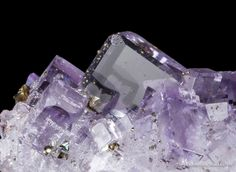 Fluorite, Jaimina Mine, Caravia, Asturias, Spain, Small Cabinet, 5.9 x 5.4 x 4.2 cm, An intergrown cluster of glassy and gemmy fluorite crystals, to 2 cm across, exhibits crystals with a faint purple core along with a richer purple color zone near the termination., For sale from The Arkenstone, www.iRocks.com. For more details on this piece and others, visit http://www.irocks.com/minerals/specimen/45196