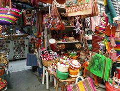 WHERE TO SHOP: TULUM MARKET <br>Tulum, Quintana Roo, Mexico</br><br> If you're in the market for artistic Mexican handicrafts, onyx, colorful textiles and leather goods, you'll find a treasure trove of brilliant bargains around almost every corner. Artisans set up shop almost daily, and shoppers can find anything ranging from jewelry to clothing, even great local eats. It is advisable to negotiate with vendors, so don't be shy!</br><br></br></br>