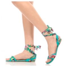 🇺🇸NWOT Faux Leather Floral Wrap Around Sandals They feature a faux leather material, woven floral contrast, wrap around construction and cushioned insoles. Wear these sandals with an A line dress for the perfect day time look.  -True to size ❗️💰= FIRM❗️ Shoes Sandals