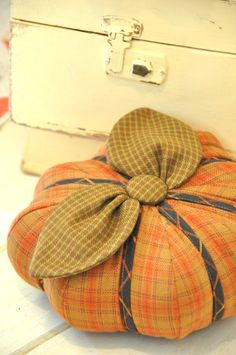 pumpkin pin cushion, tutorial by Fig Tree Quilts - http://www.allpeoplequilt.com/projects-ideas/bags-pillows/scrap-lab-table-runner-and-pumpkins_5.html