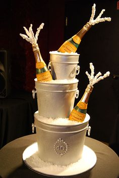 Champagne - The bubbles make my head hurt, so rather than using real bottles of Veuve on this 40th birthday cake, we opted for molding them out of chocolate.  Combined with champagne bucket cakes filled with rock candy ice, this cake gave the bubbly a run for its money in the entertainment department.
