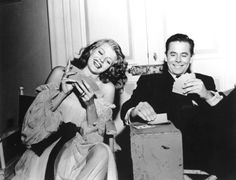 Rita Hayworth and Glenn Ford playing cards on the set of Gilda, 1946