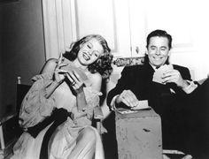 Rita Hayworth and Glenn Ford playing cards on the set of Gilda, 1946