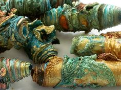 Mixed media textile art beads hand made with Tyvek - copper bronze gold teal turquoise aqua and sea green with a little bit of orange Carolyn Saxby