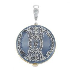 Edwardian Platinum, Gold, Blue Guilloche Enamel and Diamond Pendant-Watch, Tiffany & Co. for Sale at Auction on Wed, 12/08/2010 - 07:00 - Important Estate Jewelry | Doyle Auction House