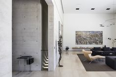 House in Rishponis a gorgeous home designed around one family's elaborate art collection. Located in central Israel, this dwelling features straight...