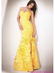 Strapless Prom Gown With All Over Ruching And Rosette Skirt