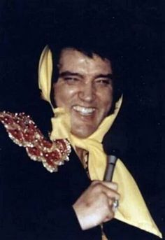March 18 - April 1st, 1975 - Great candid shot of Elvis live on stage