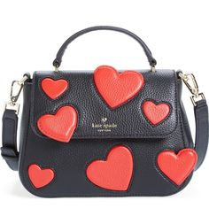 Bright, cheery heart appliqués appear to float across the front of this structured leather satchel by Kate Spade.