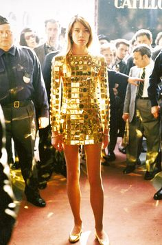 1968 - Francoise Hardy wearing a Paco Rabanne jewel dress made of gold & diamond 4 the  first international diamond fair organized by the jeweler Arnaud Clerc