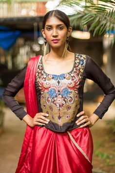 A long blouse with a kalamkari front detailed in sari work. The back on this blouse is subtly sheer with kalamkari bands running across the back.Pair this number with a saree or with a skirt and rock the kalamkari look.
