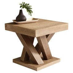 Square end table with a branching base.    Product: End tableConstruction Material: Oak woodColor: